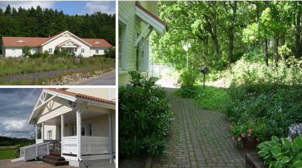 Josefiina Kodin päärakennus ja pihapiiriä pensaineen.